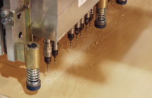 Drill is servo-driven and can accommodate a wide variety of hole patterns