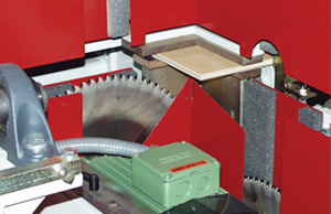 Base end panel toenotching saw with panel in position prior to cutting