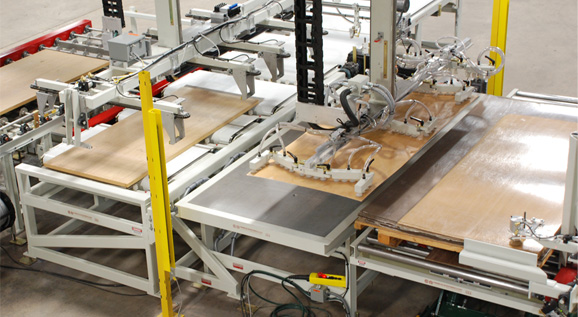 Servo-powered core feeder and sheet feeder carriages perform the layup operation. The core feeder can handle cores up to 750 lbs