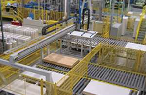 Finished panel stacking system in operation. Panels are automatically stacked based on grade assigned by the inspector