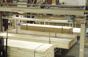 Feeder picks up lumber one layer at a time from multiple loads of different sizes