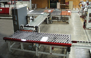 Diverting system transfers split panels to two different stacking systems, each handling a different sized part