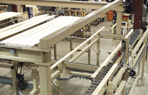 Comprehensive conveying system where singulating conveyors feed individual pieces of lumber, the size of each based on the run list