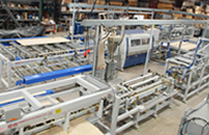 Overall view of the moulder/profile wrapper line