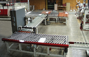 Diverting system transfers split panels to two different stacking systems