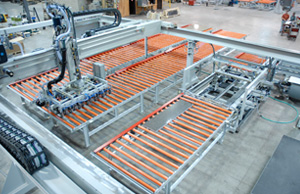 Server-controlled gantry pick and place loads and unloads stone