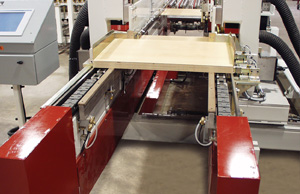 Double end tenoner sizes, dados and applies foiling to panels