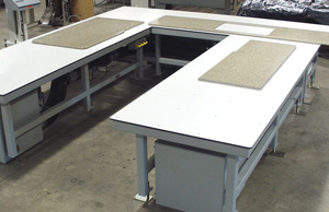 Mating of stone countertops is checked on these air tables