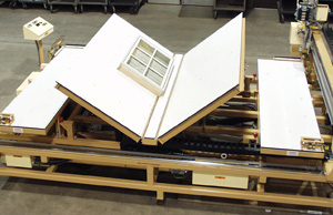 This air table station features an integrated turnover to flip windows during the assembly process