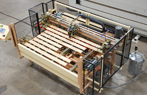 Extrusion Equipment dispensing adhesive onto window components